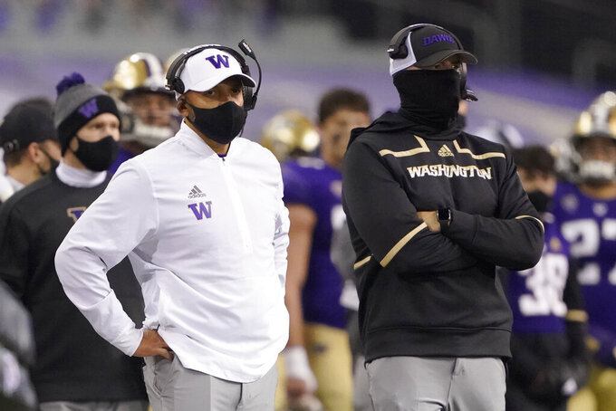 Washington coach Jimmy Lake, left, stands on the sideline during the first half of the team's NCAA college football game against Utah, Saturday, Nov. 28, 2020, in Seattle. (AP Photo/Ted S. Warren)
