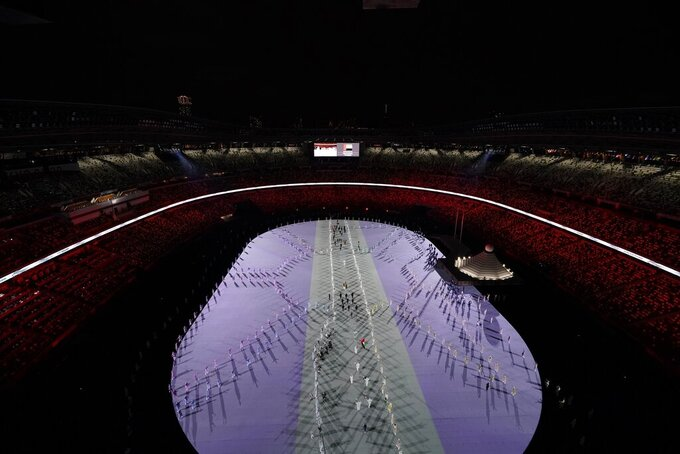 Athletes are introduced during the opening ceremony at the Olympic Stadium at the 2020 Summer Olympics, Friday, July 23, 2021, in Tokyo. (AP Photo/Morry Gash)