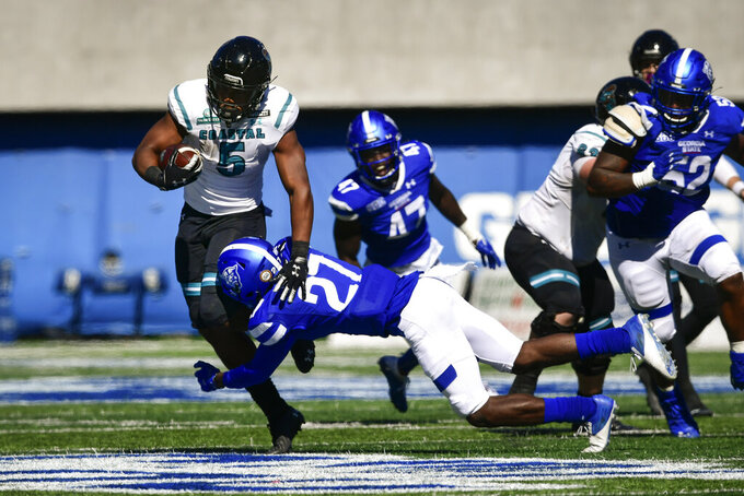 Coastal Carolina running back Shermari Jones is tackled by Georgia State cornerback Jaylon Jones during the second half of an NCAA football game Saturday, Oct. 31, 2020, in Atlanta. Coastal Carolina won 51-0. (AP Photo/John Amis)
