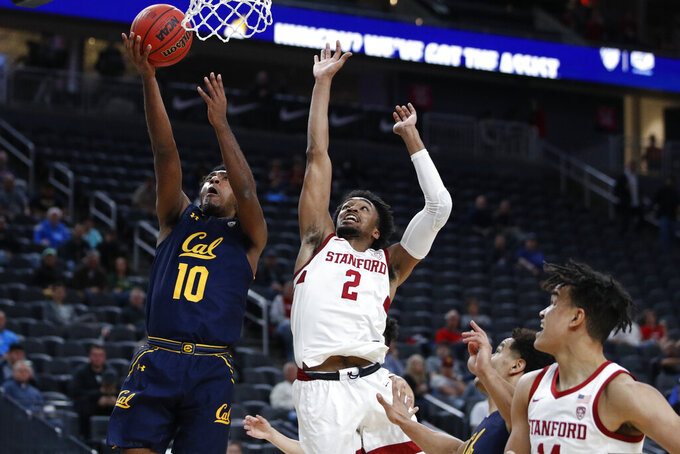 California's Kareem South (10) shoots around Stanford's Bryce Wills (2) during the first half of an NCAA college basketball game in the first round of the Pac-12 men's tournament Wednesday, March 11, 2020, in Las Vegas. (AP Photo/John Locher)