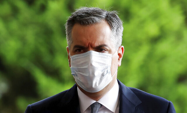 Lebanese Prime Minister-Designate Mustapha Adib wears a protective face mask as he arrives to attend a meeting with French President Emmanuel Macron at the presidential palace in Baabda, Lebanon, Tuesday, Sept. 1, 2020. rench President Emmanuel Macron returned to Lebanon on Monday, a country in the midst of an unprecedented crisis, for a two-day visit and a schedule packed with events and political talks aimed at charting a way out for the country. (Gonzalo Fuentes/Pool via AP)