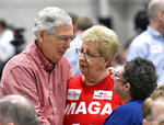 Senate Majority Leader Mitch McConnell, R-Ky., left, speaks with supporters before the start of the Graves County Republican Breakfast in Mayfield, Ky., Saturday, Aug. 3, 2019. (AP Photo/Timothy D. Easley)
