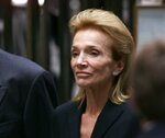FILE - In this July 23, 1999 file photo, Lee Radziwill, sister of Jacqueline Kennedy Onassis, leaves the Church of St. Thomas More in New York. Radziwill, the stylish jet setter and socialite who made friends worldwide even as she bonded and competed with her older sister Jacqueline Kennedy, has died. She was 85. Anna Christina Radziwill told The New York Times her mother died Friday, Feb. 15, 2019, of what she described as natural causes. (AP Photo/Doug Mills, File)