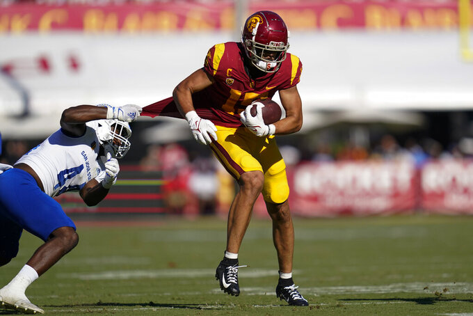 Southern California wide receiver Drake London (15) is tackled by San Jose State linebacker Jordan Cobbs (44) during an NCAA college football game Saturday, Sept. 4, 2021, in Los Angeles. (AP Photo/Ashley Landis)
