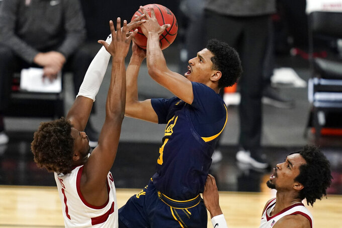 California's Jarred Hyder (3) shoots over Stanford's Daejon Davis left, and Bryce Wills during the first half of an NCAA college basketball game in the first round of the Pac-12 men's tournament Wednesday, March 10, 2021, in Las Vegas. (AP Photo/John Locher)