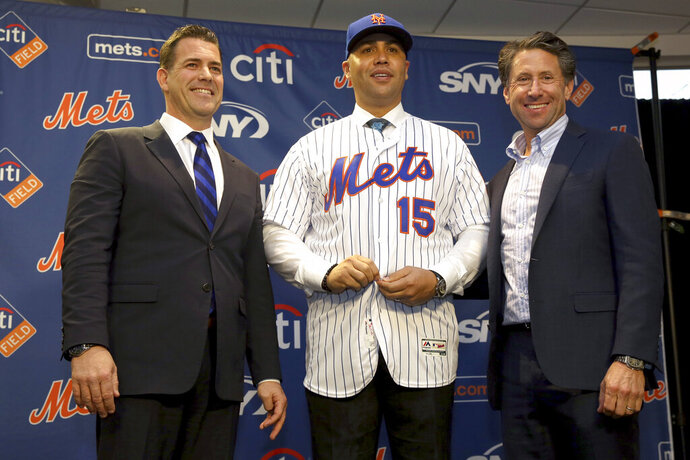 The new New York Mets manager, Carlos Beltran, center, poses for a picture with general manager Brodie Van Wagenen, left, and Mets COO Jeff Wilpon during a baseball news conference at Citi Field, Monday, Nov. 4, 2019, in New York. Beltran, two years removed from his playing career and with no managerial experience, has been picked by the Mets to replace Mickey Callaway. (AP Photo/Seth Wenig)