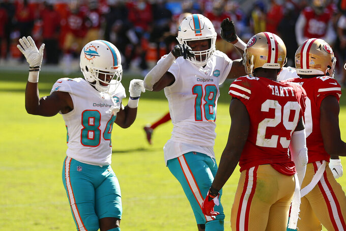 Miami Dolphins wide receiver Preston Williams (18) celebrates after scoring a touchdown with wide receiver Isaiah Ford (84) in front of San Francisco 49ers strong safety Jaquiski Tartt (29) during the second half of an NFL football game in Santa Clara, Calif., Sunday, Oct. 11, 2020. (AP Photo/Jed Jacobsohn)