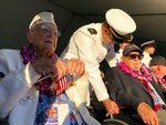 Retired U.S. Navy Cmdr. Don Long, left, and other Pearl Harbor survivors talk before the 78th anniversary of the Japanese attack on Pearl Harbor at a ceremony, Saturday Dec. 7, 2019 at Pearl Harbor, Hawaii. Long was alone on an anchored military seaplane in the middle of Kaneohe Bay across the island from Pearl Harbor when Japanese warplanes started striking Hawaii on December 7, 1941, watching from afar as the attack that killed and wounded thousands unfolded. The Japanese planes reached his base on Kaneohe Bay soon after Pearl Harbor was hit, and the young sailor saw buildings and planes explode all around him. (AP Photo/Caleb Jones)