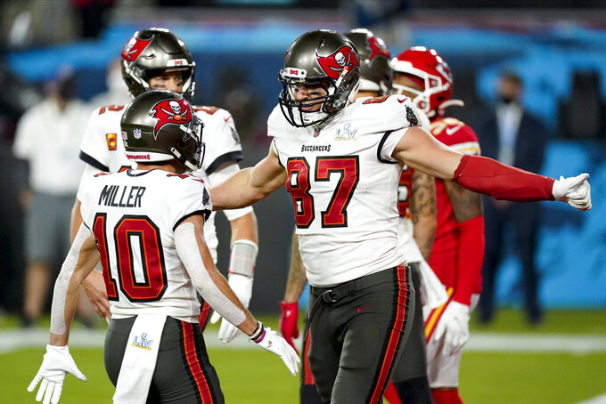 Tampa Bay Buccaneers tight end Rob Gronkowski celebrates after scoring against the Kansas City Chiefs during the first half of the NFL Super Bowl 55 football game Sunday, Feb. 7, 2021, in Tampa, Fla. (AP Photo/Ashley Landis)