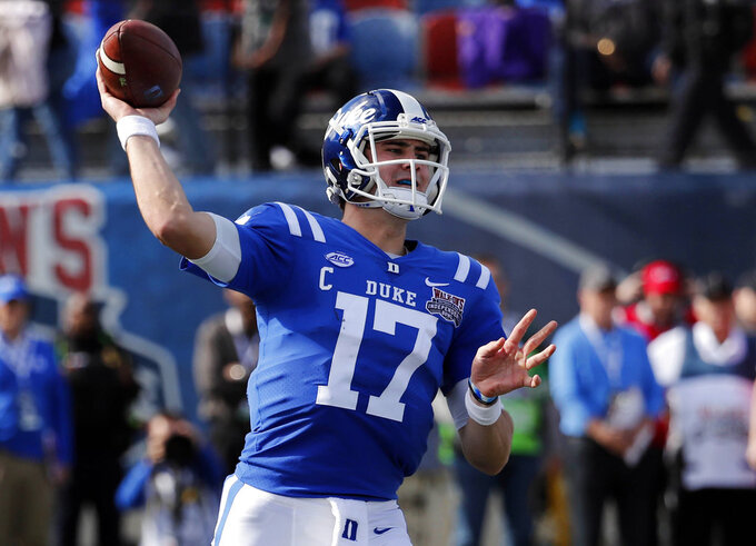 Duke quarterback Daniel Jones (17) passes against Temple during the first half of the Independence Bowl, an NCAA college football game in Shreveport, La., Thursday, Dec. 27, 2018. (AP Photo/Rogelio V. Solis)