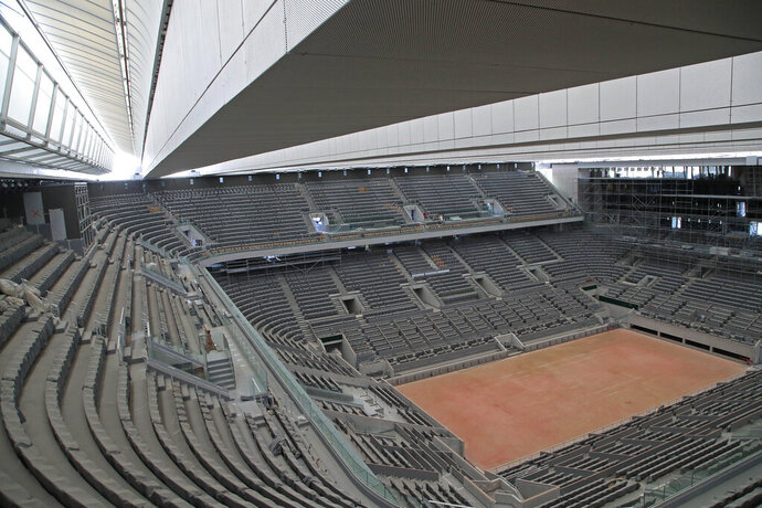 FILE - In this Wednesday, May 27, 2020 file photo, a general view of the Philippe-Chatrier tennis court with its new retractable roof during a media tour at Roland Garros stadium in Paris. Damir Dzumhur's coach called Roland Garros organizers