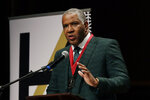 Billionaire businessman Robert F. Smith speaks after receiving the W.E.B. Dubois Medal for contributions to black history and culture, during ceremonies at Harvard University, Tuesday, Oct. 22, 2019, in Cambridge, Mass. (AP Photo/Elise Amendola)