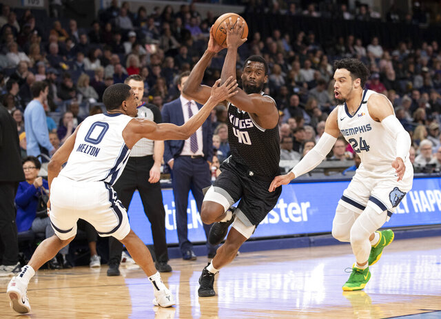 Sacramento Kings forward Harrison Barnes (40) drives to the basket while defended by Memphis Grizzlies guards De'Anthony Melton (0) and Dillon Brooks (24) during the first half of an NBA basketball game Friday, Feb. 28, 2020, in Memphis, Tenn. (AP Photo/Nikki Boertman)