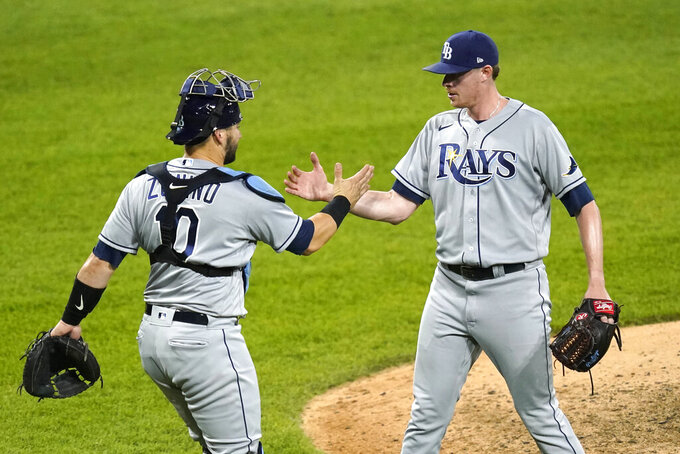 Tampa Bay Rays catcher Mike Zunino and relief pitcher Pete Fairbanks celebrate the team's 5-2 win over the Chicago White Sox after a baseball game Monday, June 14, 2021, in Chicago. (AP Photo/Charles Rex Arbogast)