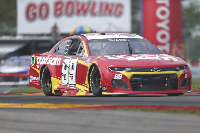 Daniel Suarez drives through the Bus Stop during a NASCAR Cup Series auto race in Watkins Glen, N.Y., on Sunday, Aug. 8, 2021. (AP Photo/Joshua Bessex)