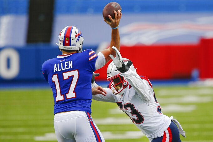 New England Patriots' Josh Uche (53) leaps for Buffalo Bills quarterback Josh Allen (17) during the first half of an NFL football game Sunday, Nov. 1, 2020, in Orchard Park, N.Y. (AP Photo/John Munson)