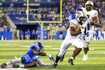 Missouri running back Tyler Badie (1) runs toward the end zone during the second half of an NCAA college football game against Kentucky in Lexington, Ky., Saturday, Sept. 11, 2021. (AP Photo/Michael Clubb)