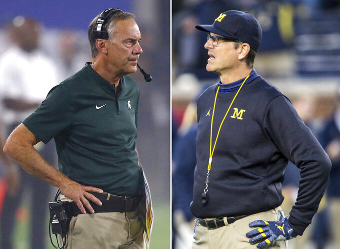 FILE - At left, in a Sept. 8, 2018, file photo, Michigan State head coach Mark Dantonio watches his team during the first half of an NCAA college football game against Arizona State, in Tempe, Ariz. At right, in an Oct. 13, 2018, file photo, Michigan head coach Jim Harbaugh is shown during an NCAA college football game against Wisconsin, in Ann Arbor, Mich. No. 6 Michigan plays at No. 24 Michigan State on Saturday. (AP Photo/File)