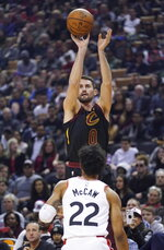 Cleveland Cavaliers' Kevin Love (0) shoots a 3-pointer over Toronto Raptors' Patrick McCaw (22) during the first half of an NBA basketball game Tuesday, Dec. 31, 2019, in Toronto. (Hans Deryk/The Canadian Press via AP)