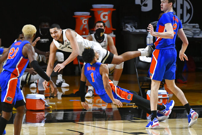 Vanderbilt forward Dylan Disu collides with Florida guard Tre Mann (1), who was trying to draw a charge during the second half of an NCAA college basketball game Wednesday, Dec. 30, 2020, in Nashville, Tenn. (AP Photo/John Amis)