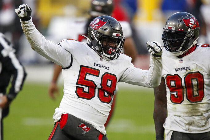 Tampa Bay Buccaneers' Shaquil Barrett (58) celebrates with teammate Jason Pierre-Paul after sacking Green Bay Packers quarterback Aaron Rodgers during the second half of the NFC championship NFL football game in Green Bay, Wis., Sunday, Jan. 24, 2021.(AP Photo/Matt Ludtke)