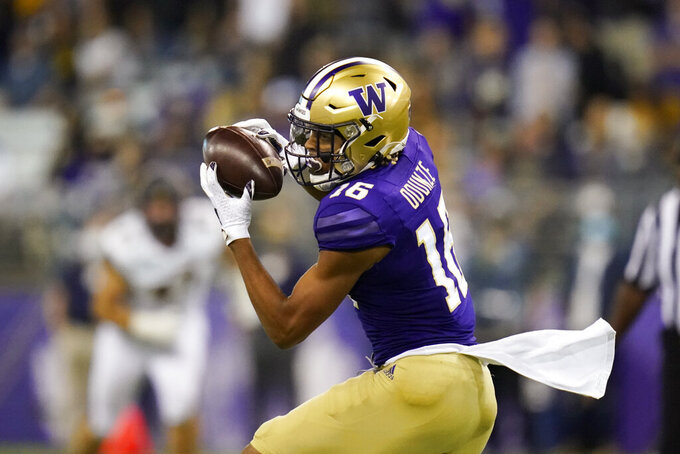 Washington's Rome Odunze catches against California in the second half of an NCAA college football game Saturday, Sept. 25, 2021, in Seattle. (AP Photo/Elaine Thompson)
