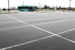 A New Castle Area Transit bus that didn't pick up or drop off passengers leaves a nearly empty park-and-ride commuter parking lot during the usual evening time for the Butler County commuters going to and from Pittsburgh, Thursday, March 26, 2020, in Zelienople, Pa. The lot had been typically two-thirds to three-quarters full on weekdays before the COVID-19 outbreak. (AP Photo/Keith Srakocic)