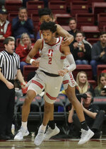 Stanford guard Bryce Wills (2) celebrates with KZ Okpala during the second half of the team's NCAA college basketball game against Washington State in Stanford, Calif., Thursday, Feb. 28, 2019. (AP Photo/Jeff Chiu)