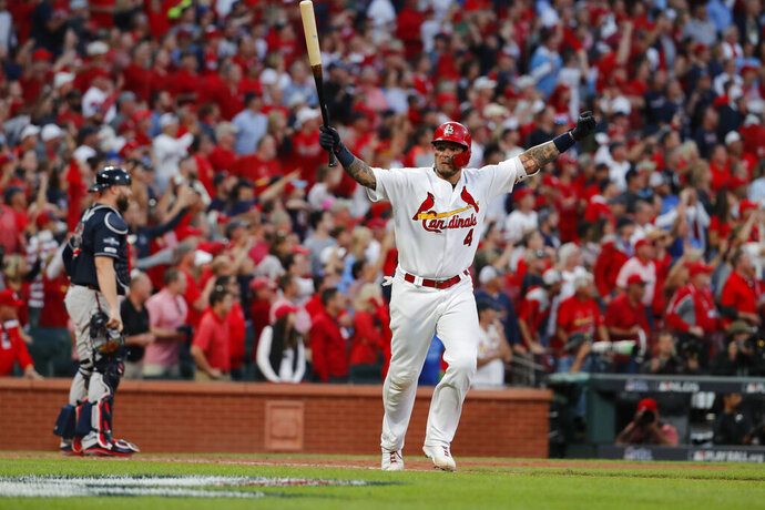 St. Louis Cardinals' Yadier Molina celebrates after hitting a sacrifice fly to score Kolten Wong and defeat the Atlanta Braves in Game 4 of a baseball National League Division Series, Monday, Oct. 7, 2019, in St. Louis. The Cardinals won 5-4.(AP Photo/Jeff Roberson)