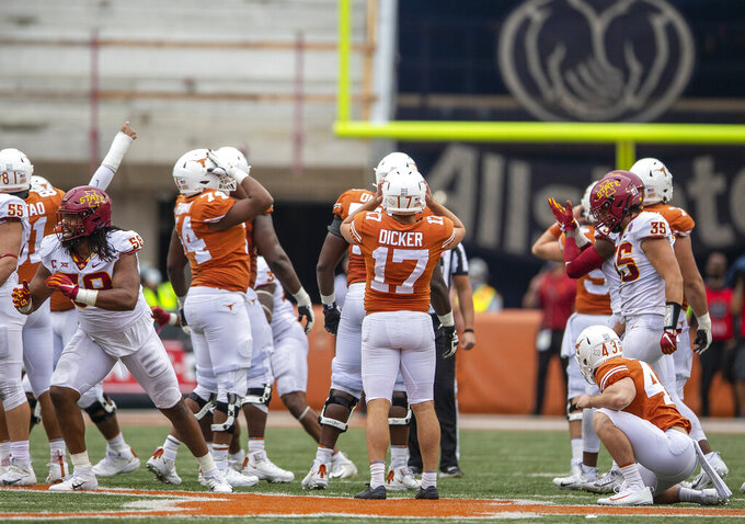 Texas kicker Cameron Dicker (17) reacts after missing the field goal to send the game into overtime against Iowa State during the second half an NCAA college football game on Saturday, Nov. 27, 2020, in Austin, Texas. (Ricardo B. Brazziell/Austin American-Statesman via AP)
