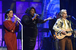 Maren Morris, left, and Brandi Carlile, right, of the Highwomen, are joined by Yola, center, during a performance at the Americana Honors & Awards show Wednesday, Sept. 22, 2021, in Nashville, Tenn. (AP Photo/Mark Zaleski)