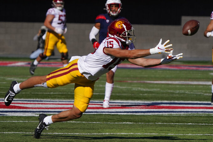 Southern California wide receiver Drake London (15) dives for the ball in the first half of an NCAA college football game against Arizona, Saturday, Nov. 14, 2020, in Tucson, Ariz. (AP Photo/Rick Scuteri)
