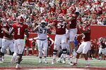 Indiana tight end Peyton Hendershot (86) celebrates with offensive lineman Harry Crider (57) after Hendershot scored on a touchdown reception during the first half of an NCAA college football game against Connecticut, Saturday, Sept. 21, 2019, in Bloomington, Ind. (AP Photo/Darron Cummings)