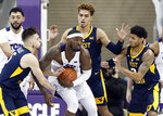 TCU forward JD Miller, center, comes down with a defensive rebound in front of West Virginia's Jordan McCabe (5), Emmitt Matthews Jr., rear, and James Bolden, right, in the second half of an NCAA college basketball game, Tuesday, Jan. 15, 2019, in Fort Worth, Texas. (AP Photo/Tony Gutierrez)