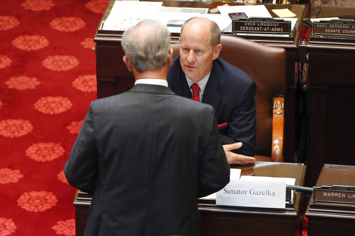 Senate Majority Leader Paul Gazelka, right, confers with Assistant Majority Leader Warren Limmer before the Republican-controlled Minnesota Senate began debate, Tuesday, June 16, 2020, in St. Paul, Minn., on a package of police accountability measures in response to the death of George Floyd. (AP Photo/Jim Mone)