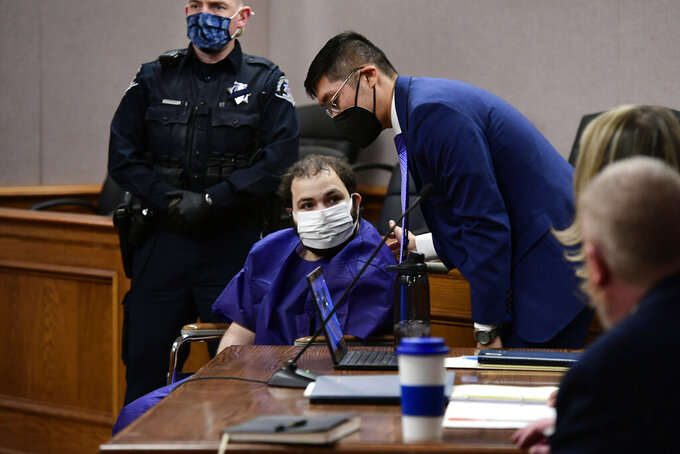 "FILE - In this Thursday, March 25, 2021 file photo, Ahmad Al Aliwi Alissa, 21, appears before Boulder District Court Judge Thomas Mulvahill at the Boulder County Justice Center in Boulder, Colo. On Friday, March 26, 2021, The Associated Press reported on a manipulated image circulating online incorrectly asserting that CNN displayed a banner during coverage of the mass shooting in Boulder, Colorado, stating the gunman was ""factually Arab, but morally white."" The manipulated screenshot of a CNN broadcast was shared thousands of times on Facebook this week, fooling social media users who did not realize it was initially shared as satire. (Helen H. Richardson/The Denver Post via AP, Pool)"