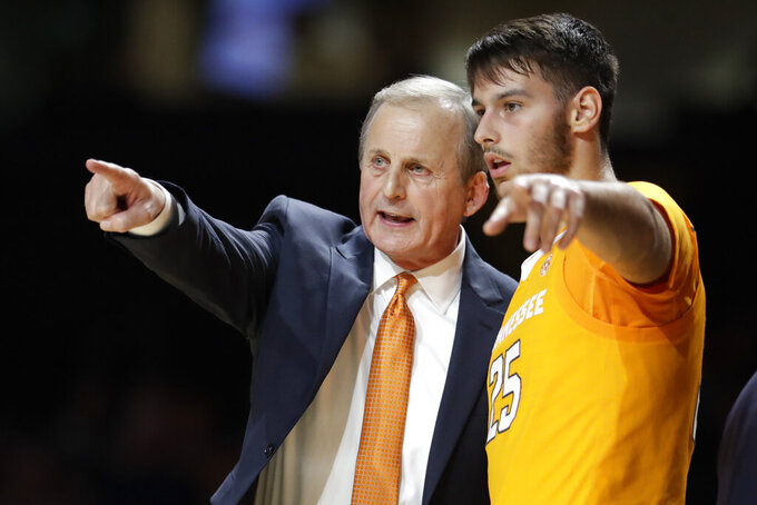 FILE - In this Saturday, Jan. 18, 2020, file photo, Tennessee coach Rick Barnes talks with guard Santiago Vescovi, of Uruguay, during the second half of the team's NCAA college basketball game against Vanderbilt in Nashville, Tenn. With competition canceled across all NCAA divisions due to the coronavirus, many foreign athletes face a dilemma, return home or stay. Tennessee's men's basketball team has players from France, Serbia, Uruguay and Finland, which meant Mary-Carter Eggert, the director of basketball operations, became a travel agent, looking for the best flights.   (AP Photo/Mark Humphrey, File)