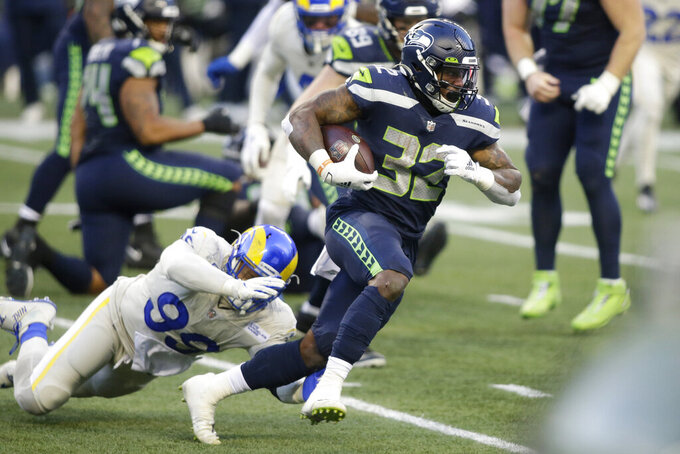 Seattle Seahawks running back Chris Carson (32) rushes against the Los Angeles Rams during the second half of an NFL football game, Sunday, Dec. 27, 2020, in Seattle. (AP Photo/Scott Eklund)