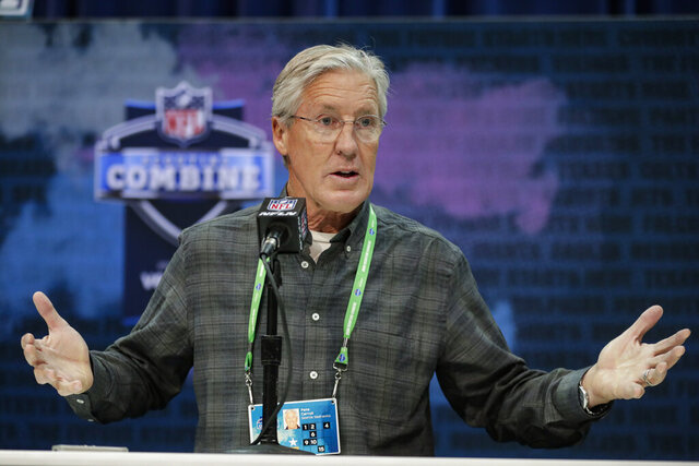 FILE - In this Feb. 25, 2020, file photo, Seattle Seahawks head coach Pete Carroll speaks during a press conference at the NFL football scouting combine in Indianapolis. The NFL Draft is April 23-25. (AP Photo/Michael Conroy, File)