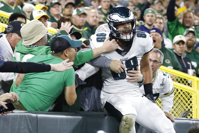 Philadelphia Eagles tight end Dallas Goedert celebrates with fans after scoring a touchdown during the first half of an NFL football game against the Green Bay Packers on Thursday, Sept. 26, 2019, in Green Bay, Wis. (AP Photo/Jeffrey Phelps)
