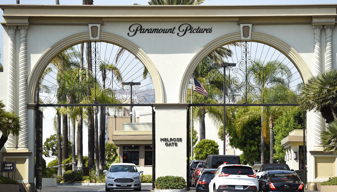 """FILE - The Paramount Pictures gate is pictured on Aug. 23, 2016, in Los Angeles. The studio is joining other major Hollywood studios in slashing the traditional 90-day theatrical window. ViacomCBS on Wednesday, Feb. 24, 2021, announced that the studio's films, including """"Mission: Impossible 7"""" and """"A Quiet Place Part II,"""" will go to its fledgling streaming service, Paramount+, after 45 days in theaters. (Photo by Chris Pizzello/Invision/AP, File)"""