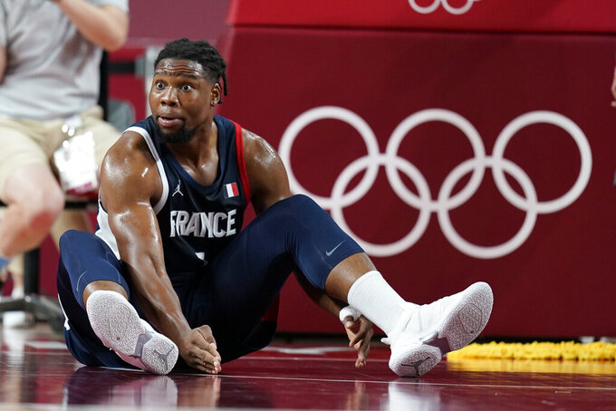 France's Guerschon Yabusele (7) questions a foul call during a men's basketball quarterfinal round game against Italy at the 2020 Summer Olympics, Tuesday, Aug. 3, 2021, in Saitama, Japan. (AP Photo/Charlie Neibergall)
