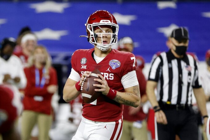 Oklahoma quarterback Spencer Rattler drops back to pass during the first half of the team's Cotton Bowl NCAA college football game against Florida in Arlington, Texas, Wednesday, Dec. 30, 2020. (AP Photo/Michael Ainsworth)