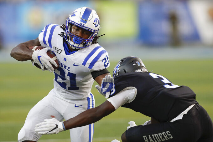 Duke running back Mataeo Durant (21) tries to get past Middle Tennessee safety Gregory Grate Jr. (3) in the first half of an NCAA college football game Saturday, Sept. 14, 2019, in Murfreesboro, Tenn. (AP Photo/Mark Humphrey)
