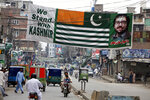 Pakistani streets are decorated with banners and flags to express solidarity with Indian Kashmiris, on Independence Day, in Peshawar, Pakistan, Wednesday, Aug. 14, 2019. Pakistanis commemorated its independence from British colonial rule in 1947. (AP Photo/Muhammad Sajjd)