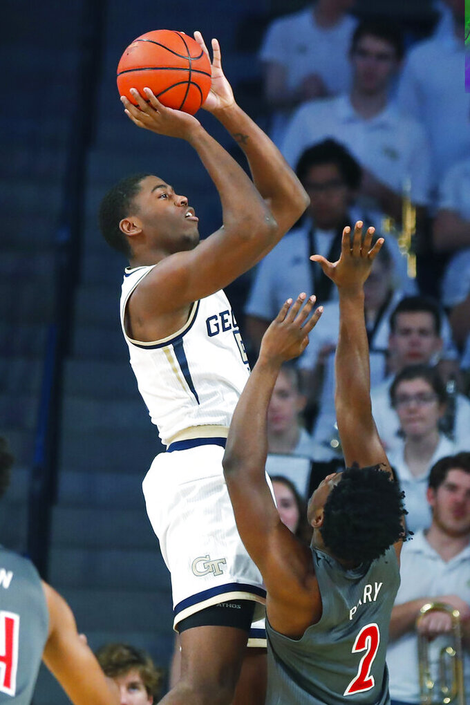 Georgia Tech forward Moses Wright (5) shoots during the first half of an NCAA college basketball game against Louisville in Atlanta, Wednesday, Feb. 12, 2020. (AP Photo/Todd Kirkland)