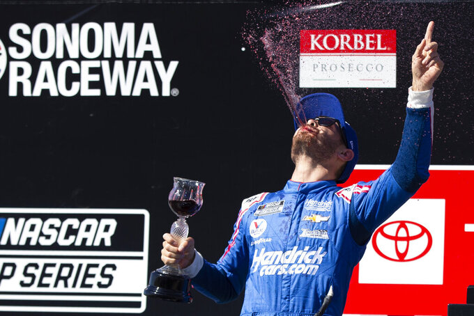 Kyle Larson celebrates his victory in a NASCAR Cup Series auto race, Sunday, June 6, 2021, at Sonoma Raceway in Sonoma, Calif. (AP Photo/D. Ross Cameron)