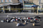 """FILE - In this Sunday, Aug. 4, 2019, file photo, shoes are piled outside the scene of a mass shooting in Dayton, Ohio. In a period of around 10 weeks in 2019, Dayton dealt with a Ku Klux Klan rally, a string of devastating tornadoes, and a mass shooting that killed nine people. Mayor Nan Whaley's end-of-the-year reflections include searing memories of the natural disaster and attack as she looks ahead to a year dedicated to """"healing and transformation."""" (AP Photo/John Minchillo, File)"""