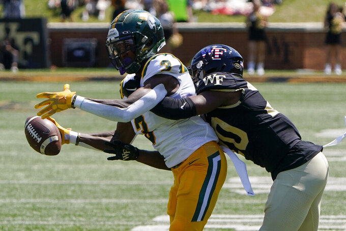 Norfolk State wide receiver Justin Smith catches a pass in front of Wake Forest defensive back Coby Davis during the first half of a NCAA college football game Saturday, Sept. 11, 2021, in Winston-Salem, N.C. (AP Photo/Chris Carlson)