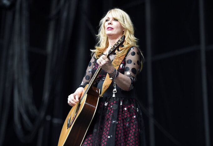 """FILE - Nancy Wilson of Heart performs at RFK Stadium in Washington on July 4, 2015. Wilson released her first solo album, """"You and Me."""" (Photo by Nick Wass/Invision/AP, File)"""